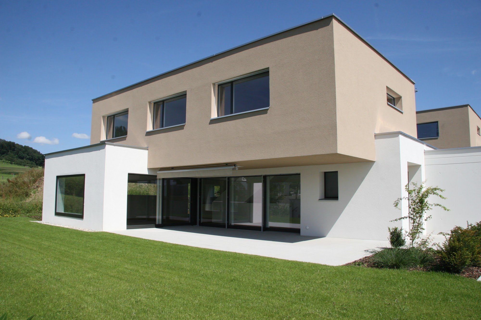 Wohnen EFH Drei EFH Gassmatt Architektur,Wohnungsbau,Wohnhäuser,Einfamilienhäuser,Mehrfamilienhäuser